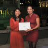 Dr. Adriana Aguilera-Gonzalez receives her award from the Dr Lee Yoot Khuan